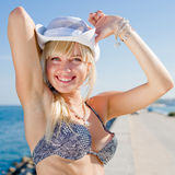 Fine girl in white hat outdoors. Attractive young long-haired blond woman in white hat at the sea Stock Photo