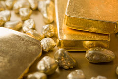 Fine gold. Ingots and nuggets Stock Photo