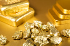 Fine gold. Ingots and nuggets Stock Images