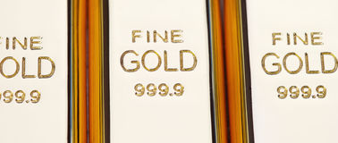 Fine gold 999,9. Set of gold ingots Royalty Free Stock Photos