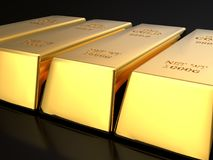 Fine Gold bars. 3D rendering of row of fine gold ingots on black surface Royalty Free Stock Image