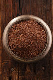 Fine grated chocolate in bowl on wood , shallow dof Royalty Free Stock Photos