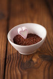 Fine grated chocolate and heart marshmallow candy in  bowl  , wo Stock Photography