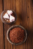 Fine grated chocolate and heart marshmallow candy in iron bowl Stock Photography