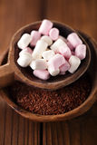 Fine grated chocolate and marshmallow candy  in old spoon, woode Royalty Free Stock Photos