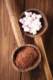 Fine grated chocolate and marshmallow candy  in old spoon, woode Royalty Free Stock Images