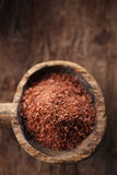 Fine grated chocolate in old wooden spoon Royalty Free Stock Photography