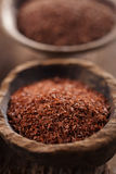 Fine grated chocolate in old wooden spoon Royalty Free Stock Image