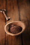 Fine grated chocolate  and roasted cocoa beans Stock Photo