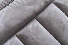 Fine grigia dell'estratto del sofà della pelle scamosciata su Immagini Stock