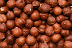 Fine hazelnuts close up background. Fine brown hazelnuts close up background stock photo
