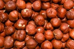 Fine hazelnuts close up background. Fine brown hazelnuts close up background stock images