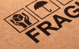 Fine image close up of fragile symbol on cardboard. Selective focus stock images