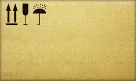 Fine image close-up of grunge black fragile symbol on cardboard.  stock images