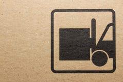 Fine image close-up of grunge black fragile symbol on cardboard.  royalty free stock photos