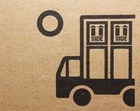 Fine image close-up of grunge black fragile symbol on cardboard.  royalty free stock photography