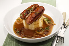 Fine irish dinning with banger and mash. Traditional irish dish banger and mash, bangers with mashed potatoes, sausages with grilled onions and gravy Stock Photography