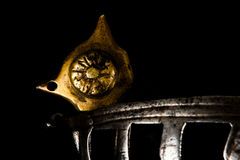 A fine ironwork sword hilt element. A close-up of the fine metalwork on an antique Venetian or Dalmatian schiavona sword hilt Stock Photography