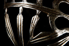 A fine ironwork sword hilt element. A close-up of the fine metalwork on an antique Venetian or Dalmatian schiavona sword hilt Stock Photos