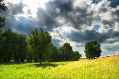 Fine landscape with hard sky and sun ray Royalty Free Stock Images