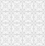 Fine low contrasting gray patterns on white background. Filigree geometric lace ornament, tile with repeatable ornate elements in victorian style, vintage Royalty Free Stock Photo
