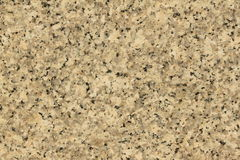 Fine lucidata di struttura del grano del pavimento della pietra del granito su immagine stock