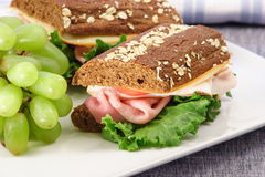 Fine lunch sandwich. Sandwich with fresh honey wheat bread and fine honey ham Royalty Free Stock Photography