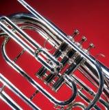 Fine in marcia del corno francese Fotografia Stock