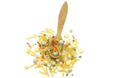 Fine mixture of noodles with vegetables in a wooden spoon. On a white background Stock Photo