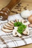 Fine mushroom slices. Mushroom slices on wooden table Royalty Free Stock Photo