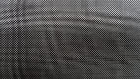 Fine nera del fondo tessuta tela del materiale composito della fibra del carbonio sulla vista immagine stock libera da diritti