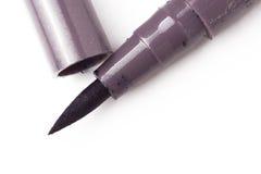 Fine nera liquida dell'eye-liner sulla macro della penna Fotografia Stock Libera da Diritti