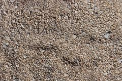 Fine pebbles of a brown shade. Beach ground. Natural material for design, decoration and construction. Sanded granite and hard min stock image