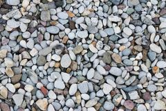 Fine pebbles of a gray shade. Beach ground. Natural material for design, decoration and construction. Sanded granite and hard mine. Rals. Geology and minerals stock photo