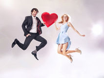 Fine photo of cheerful couple holding a heart Royalty Free Stock Images