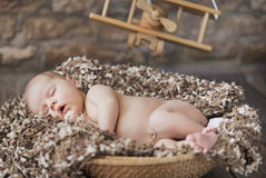 Fine picture of baby sleeping in toy room Royalty Free Stock Images