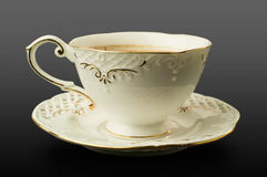 Fine porcelain cup and saucer with coffee Royalty Free Stock Photo
