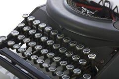 Fine portatile della macchina da scrivere dell'annata in su sui tasti Fotografie Stock