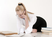 Fine portrait of young blonde teacher. In the classroom Stock Photo