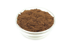 Fine powder of ground coffee in a glass cup Royalty Free Stock Photo
