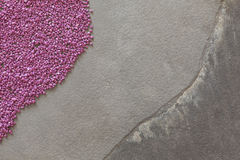 Fine purple grit on stone background, space for text Royalty Free Stock Photography
