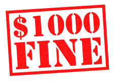$1000 FINE. Red Rubber Stamp over a white background Royalty Free Stock Photos