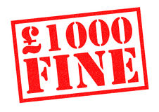 £1000 FINE. £1000 FINE red Rubber Stamp over a white background Royalty Free Stock Photos