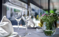 Fine restaurant dinner table setting. By wineglass and napkin Stock Images