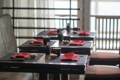 Fine restaurant dinner tables set up before opening for customer. Fine restaurant dinner tables set up before opening  for customers Royalty Free Stock Photo