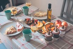 Fine rustic breakfast. On table with tablecloth - scrambled eggs, fruit, tea and coffee royalty free stock photos