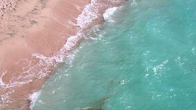 Fine sand of Balangan beach are washed by the foamy ocean waves. Top view. Fine sand of Balangan beach are washed by the foamy waves of azure Indian ocean at stock video