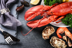 Fine selection of crustacean for dinner. Lobster, oysters and sh. Rimps on dark background stock photo