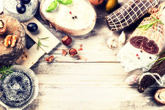 Fine selection of dry meat, sausages and French cheese. Gourmet Stock Images