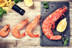 Fine selection of jumbo shrimps for dinner. Food background Stock Photos